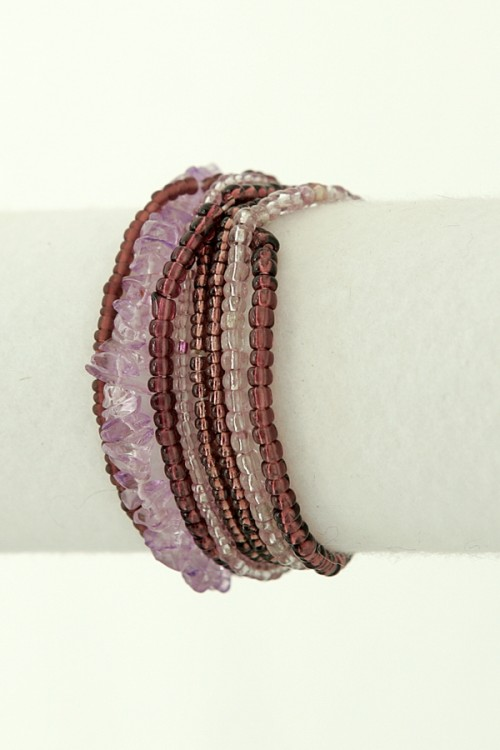 Stretchy beaded bracelet in a delicate mix of lilacs, berry and crystal coloured beads.