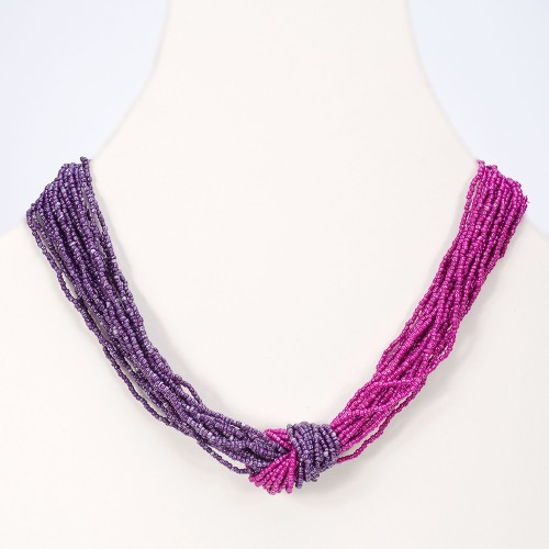 Medium length seed bead necklace in a knot of fuchsia and purple seed beads.